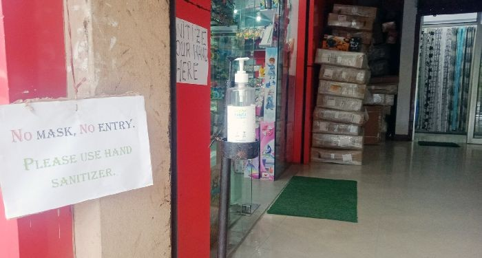 Signage in front of a shop in Kohima informing customers to wear face masks. (Morung Photo)