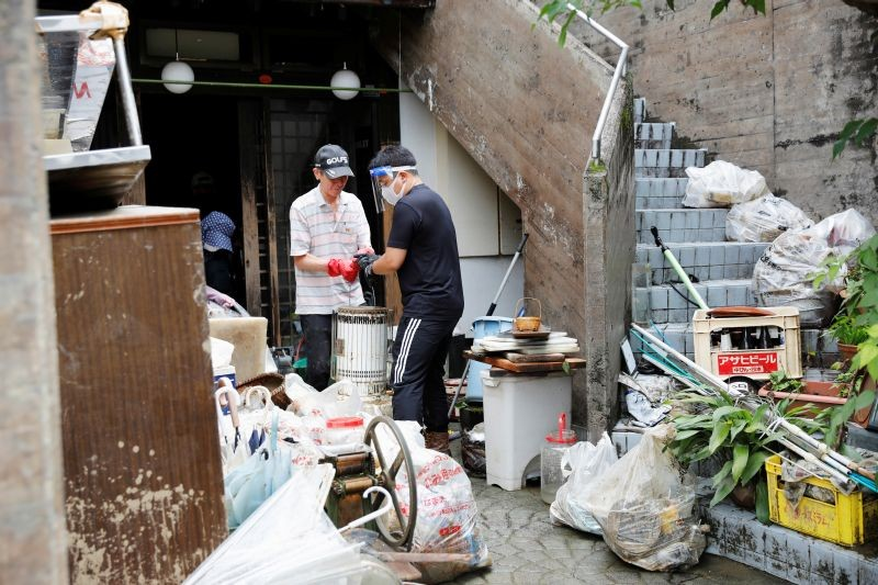People work as they clear debris after floods caused by torrential rain in Hitoyoshi, Kumamoto Prefecture, southwestern Japan on July 8, 2020.( REUTERS Photo)