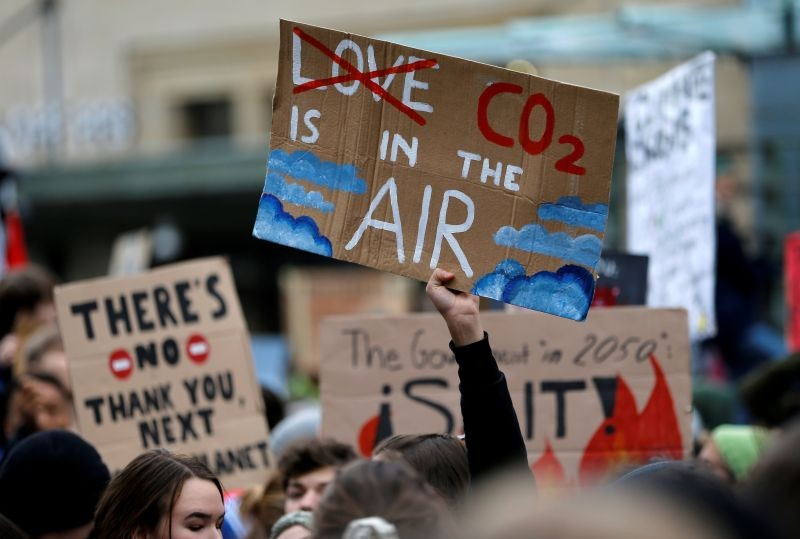 A climate change activist holds a sign during a demonstration of the Fridays for Future movement in Lausanne, Switzerland on January 17, 2020. (REUTERS File Photo)