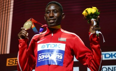 FILE PHOTO: Gold medalist Kenya's Conseslus Kipruto on the podium REUTERS/Ibraheem Al Omari/File photo