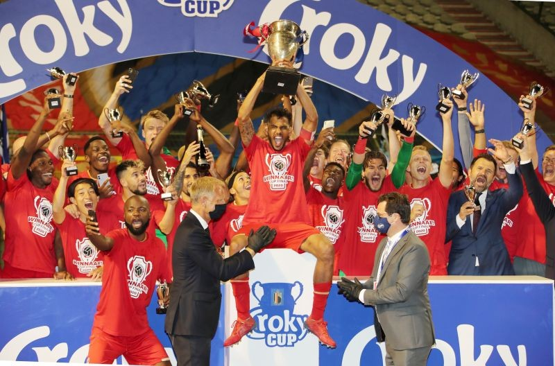 Royal Antwerp players celebrate with the trophy after winning the Belgian Cup Bart Vandenbroucke/Pool via REUTERS