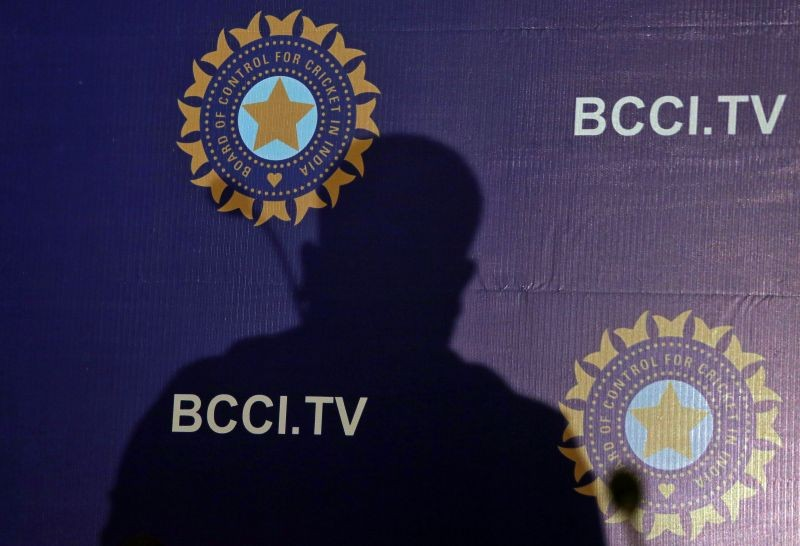 The shadow of a man falls on a backdrop with the logo of the India's cricket board BCCI before the start of a news conference to announce its cricket team's coach, in Mumbai, India, August 16, 2019. REUTERS/Francis Mascarenhas/File Photo