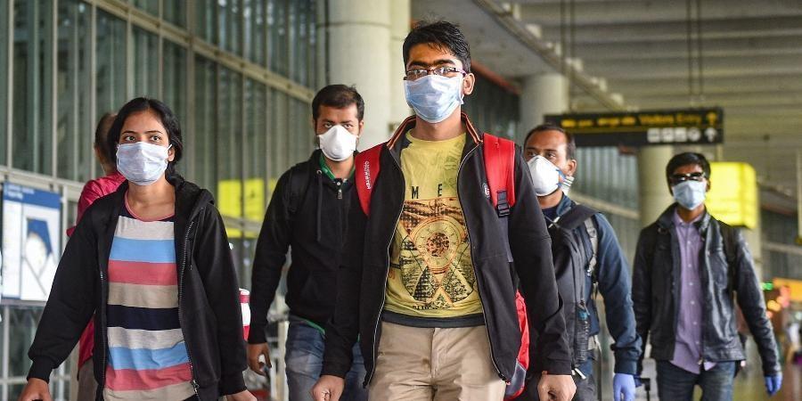 Passengers wear masks in the wake of coronavirus pandemic at the Kolkata airport. (Photo | PTI)