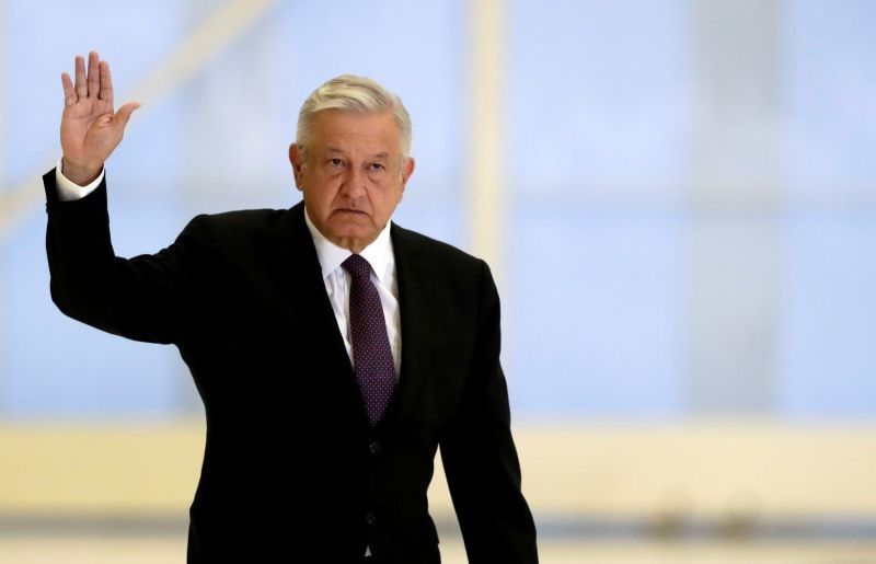 Mexico's President Andres Manuel Lopez Obrador waves as he arrives to hold a news conference at the presidential hangar, with the presidential plane in the background, at Benito Juarez International Airport in Mexico City, Mexico on July 27, 2020. (REUTERS File Photo)