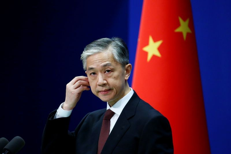 Chinese Foreign Ministry spokesman Wang Wenbin listens to a question from a journalist during a news conference in Beijing, China on July 27, 2020. (REUTERS File Photo)