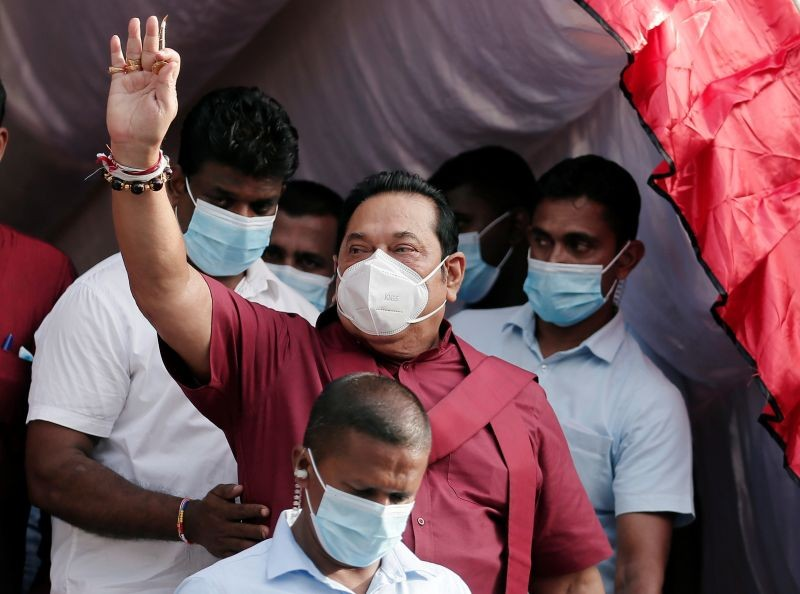Leader of Sri Lanka People's Front party Mahinda Rajapaksa, wearing a protective mask, waves at his supporters during a campaign rally  on  August 1, 2020. (REUTERS File Photo)
