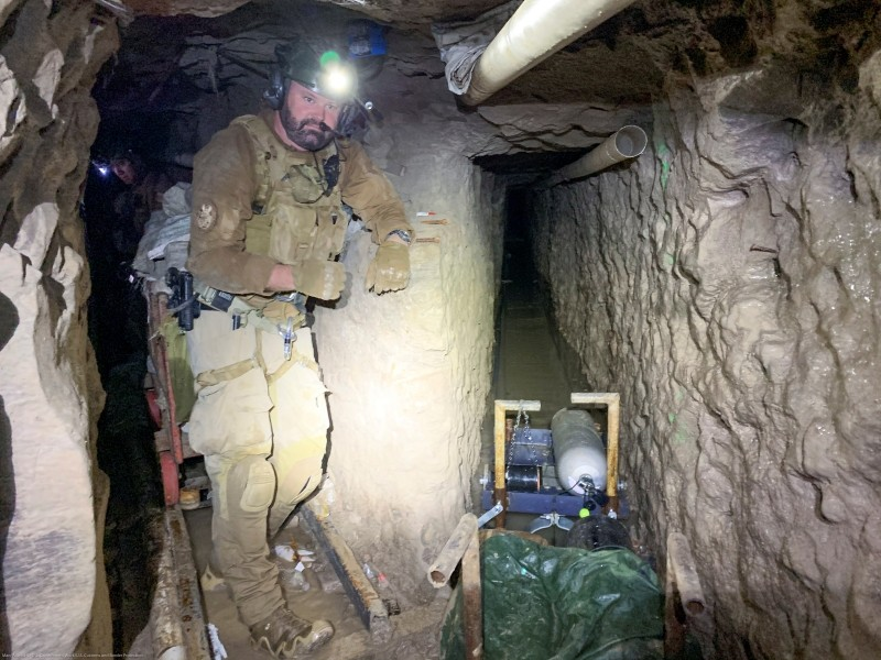 "A U.S. Customs and Border Protection (CBP) agent stands by for security at a tunnel spur that went off into a different direction, during mapping of the ""Baja Metro Tunnel"", which CBP says is the longest illicit cross-border tunnel ever discovered along the Southwest border, in Otay Mesa, California, U.S. November 13, 2019. Picture taken November 13, 2019. U.S. Customs and Border Protection/Handout via REUTERS."
