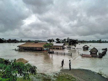 Partially submerged houses seen during flood after monsoon rainfall, in Golaghat, Assam. (PTI File Photo)
