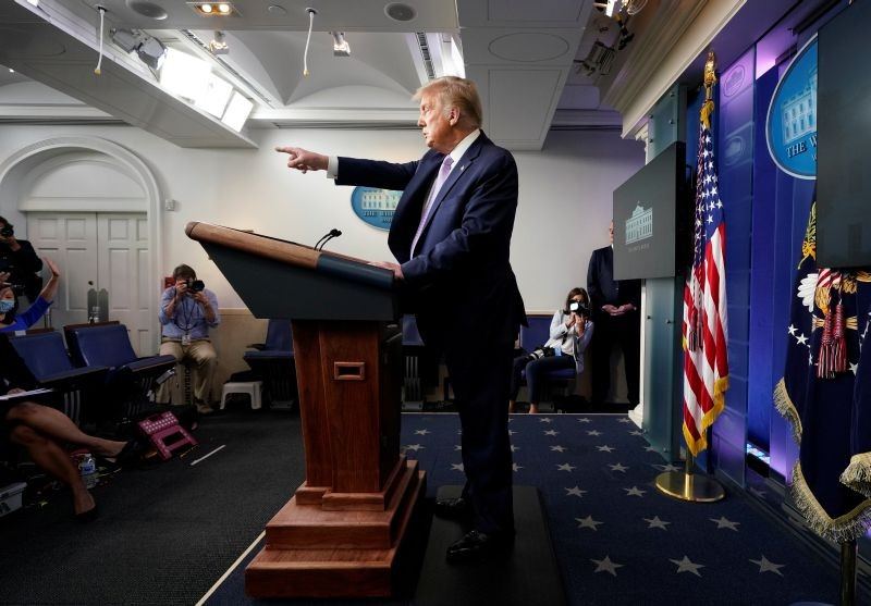 U.S. President Donald Trump points to a reporter as he holds a coronavirus disease (COVID-19) pandemic briefing in the Brady Press Briefing Room of the White House in Washington, US on August 5, 2020. (REUTERS Photo)