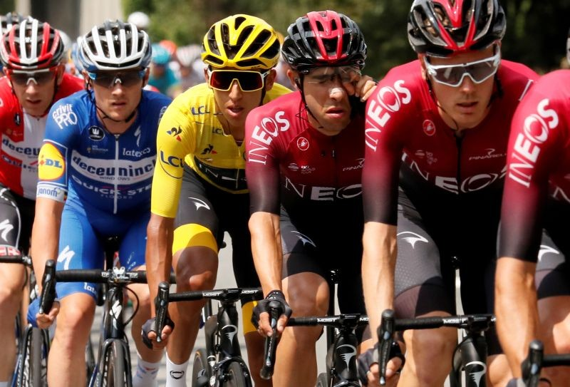 FILE PHOTO: Team INEOS rider Egan Bernal of Colombia, wearing the overall leader's yellow jersey, in the peloton. REUTERS/Gonzalo Fuentes/File Photo