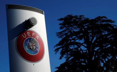 FILE PHOTO: A logo is pictured outside the UEFA in Nyon, Switzerland, February 28, 2020. REUTERS/Denis Balibouse/File Photo