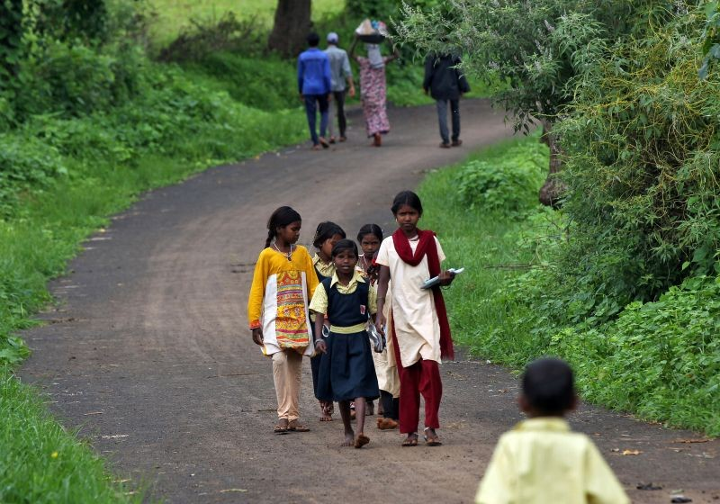 Children walk to attend a class of pre-recorded lessons after schools were closed following the coronavirus outbreak, in Dandwal village in the western state of Maharashtra on July 23, 2020. (REUTERS File Photo)