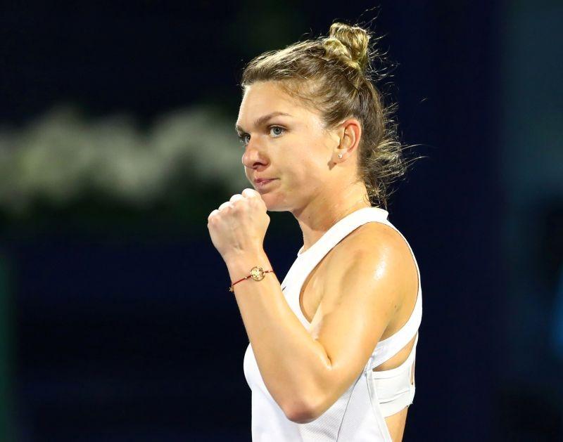 FILE PHOTO: Romania's Simona Halep reacts during her semi final match against Jennifer Brady of the U.S. REUTERS/Ahmed Jadallah/File Photo