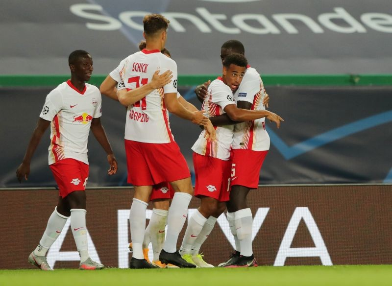 RB Leipzig's Tyler Adams celebrates scoring their second goal with teammates, as play resumes behind closed doors following the outbreak of the coronavirus disease (COVID-19) Miguel A. Lopes/Pool via REUTERS