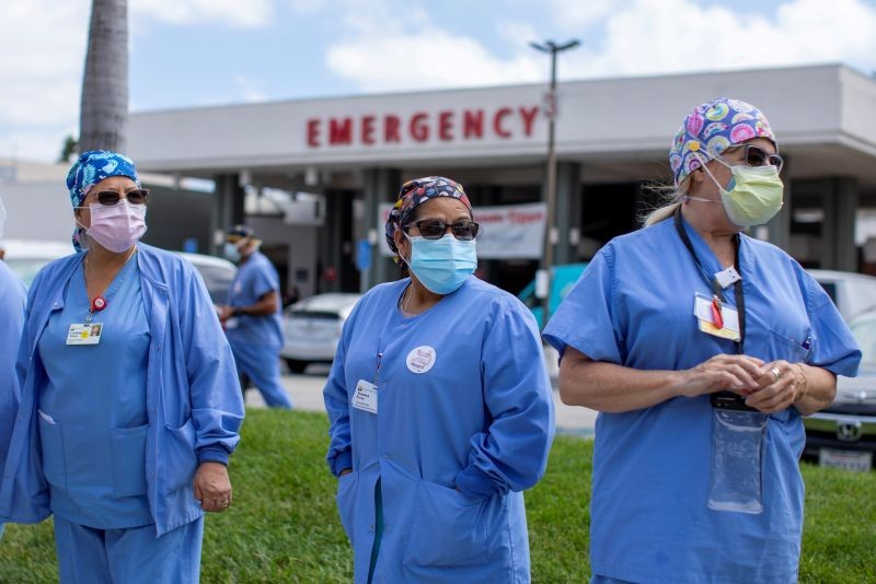 Healthcare workers at Fountain Valley Regional Hospital hold a rally outside their hospital for safer working conditions during the outbreak of the coronavirus disease (COVID-19) in Fountain Valley, California, US on August 6, 2020. (REUTERS Photo)