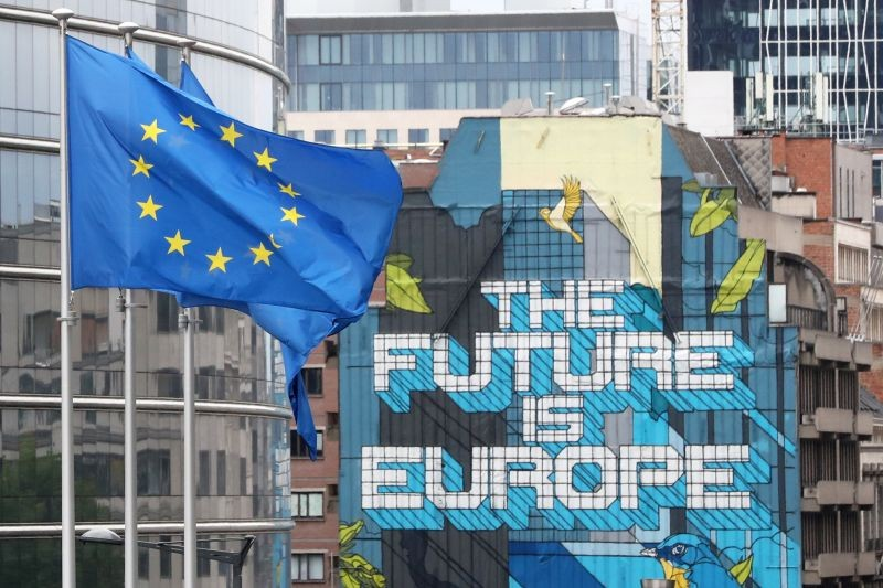 European Union flags flutter outside the European Commission headquarters in Brussels, Belgium on July 16, 2020. (REUTERS File Photo)