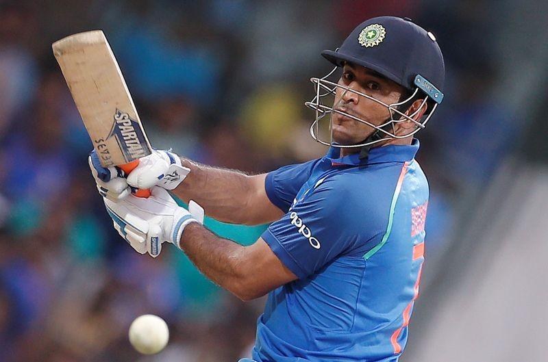 FILE PHOTO: India's Mahendra Singh Dhoni plays a shot. REUTERS/Adnan Abidi/File photo