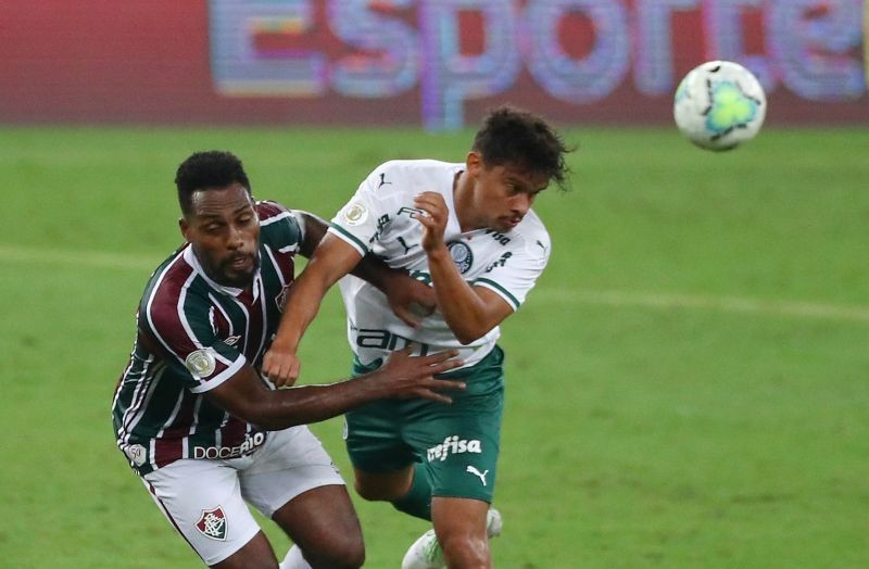 Palmeiras' Gustavo Scarpa in action with Fluminense's Luccas Claro, following the resumption of play behind closed doors after the outbreak of the coronavirus disease (COVID-19) REUTERS/Pilar Olivares