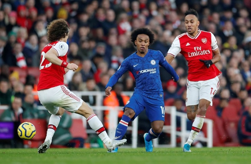 FILE PHOTO: Soccer Football - Premier League - Arsenal v Chelsea - Emirates Stadium, London, Britain - December 29, 2019 Chelsea's Willian in action with Arsenal's David Luiz and Pierre-Emerick Aubameyang  Action Images via Reuters/Matthew Childs