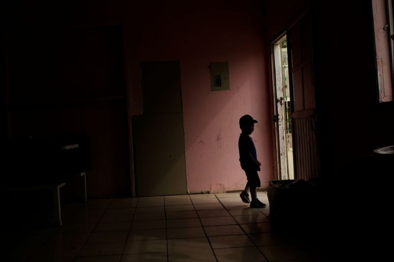 A Central American migrant child, asylum seeker sent back to Mexico from the U.S. under Migrant Protection Protocols (MPP) along his parents, is silhouetted at the Pan de Vida migrant shelter at Anapra neighborhood, in Ciudad Juarez, Mexico on September 13, 2019. (REUTERS File Photo)