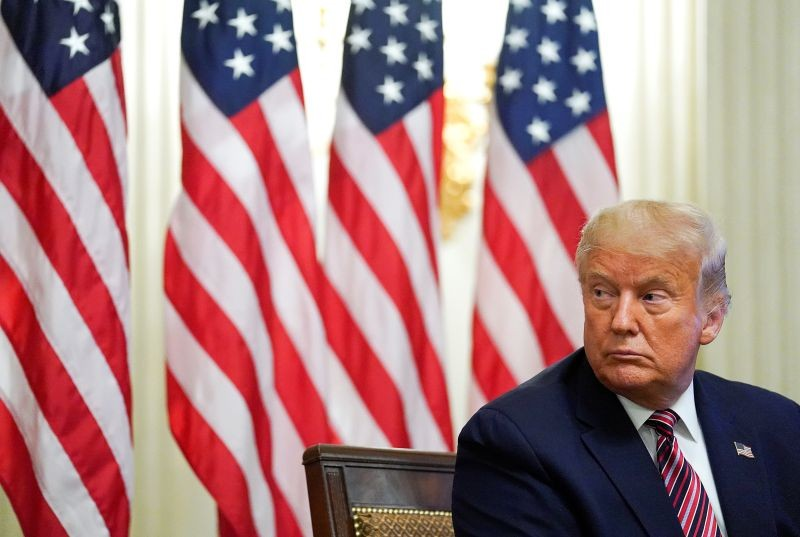 U.S. President Donald Trump listens during a coronavirus disease (COVID-19) pandemic response event about reopening schools in the State Dining Room at the White House in Washington, US on August 12, 2020. (REUTERS Photo)