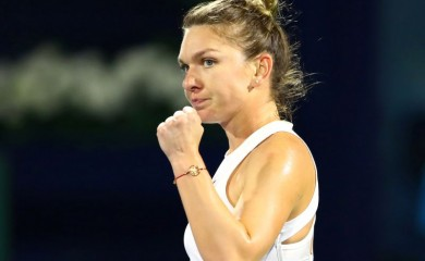 FILE PHOTO: Romania's Simona Halep reacts during her semi final match against Jennifer Brady of the U.S. REUTERS/Ahmed Jadallah/File Photo