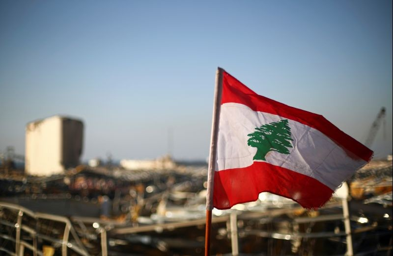 A Lebanese flag is pictured, in the aftermath of a massive explosion, in Beirut's damaged port area, Lebanon on August 17, 2020. (REUTERS File Photo)
