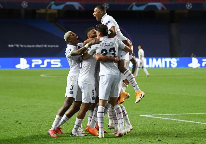 Paris St Germain's Marquinhos celebrates scoring their first goal with Kylian Mbappe and teammates, as play resumes behind closed doors following the outbreak of the coronavirus disease (COVID-19) David Ramos/Pool via REUTERS