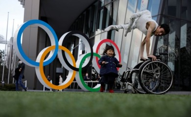 FILE PHOTO: Kenta Kambara, 34, poses for a photo while his daughter Shiori, 2, walks past him, next to an Olympic Rings symbol in front of the Japan Olympic Museum in Tokyo, Japan, February 22, 2020. REUTERS/Kim Kyung-Hoon