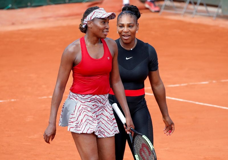 Tennis - French Open - Roland Garros, Paris, France - May 30, 2018    Serena Williams and Venus Williams of the U.S. celebrate after winning their first round doubles match against Japan's Shuko Aoyama and Miyu Kato   REUTERS/Charles Platiau/File Photo