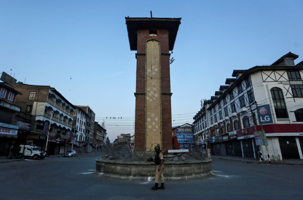 An Indian Central Reserve Police Force (CRPF) officer stands guard at an empty square during a lockdown on the first anniversary of the revocation of Kashmir's autonomy, in Srinagar on  August 5.  (REUTERS/Danish Ismail)