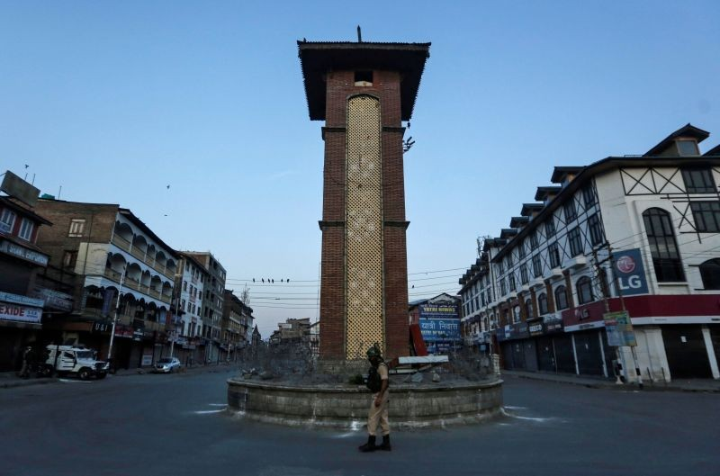 An Indian Central Reserve Police Force (CRPF) officer stands guard at an empty square during a lockdown on the first anniversary of the revocation of Kashmir's autonomy, in Srinagar on August 5. (REUTERS Photo)