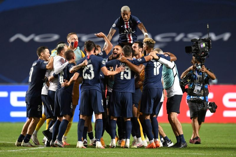 Paris St Germain players celebrate their win after the match, as play resumes behind closed doors following the outbreak of the coronavirus disease (COVID-19) David Ramos/Pool via REUTERS