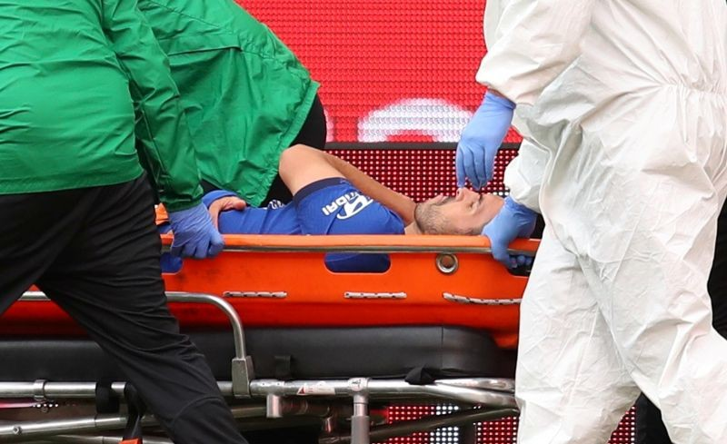 FILE PHOTO: Chelsea's Pedro is stretchered off after sustaining an injury, as play resumes behind closed doors following the outbreak of the coronavirus disease (COVID-19) Pool via REUTERS/Catherine Ivill/File Photo