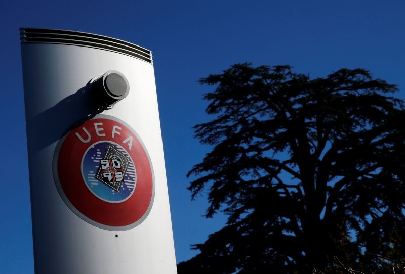 FILE PHOTO: A logo is pictured outside the UEFA in Nyon, Switzerland, February 28, 2020. Picture taken February 28, 2020. REUTERS/Denis Balibouse