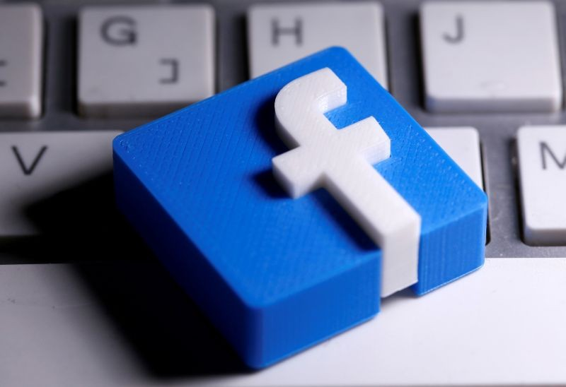 A 3D-printed Facebook logo is seen placed on a keyboard in this illustration taken on March 25, 2020. (REUTERS File Photo)