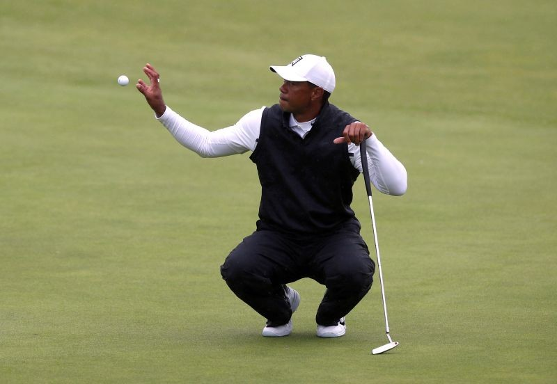 FILE PHOTO: Tiger Woods of the U.S. on the 18th hole during the second round REUTERS/Paul Childs/File Photo