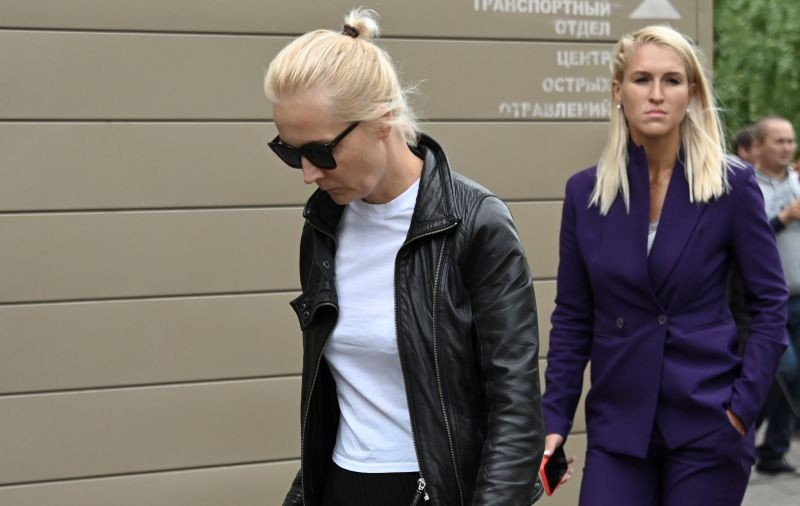 "Yulia Navalnaya, wife of Russian opposition leader Alexei Navalny, and Anastasia Vasilyeva, Alexei Navalny's personal physician, walk outside a hospital, where Alexei receives medical treatment in Omsk, Russia on August 21, 2020. Alexei Navalny began feeling ill, en route from Tomsk to Moscow, on a plane which made an emergency landing in Omsk due to his serious condition. The sign reads: ""Acute poisoning centre"". (REUTERS Photo)"