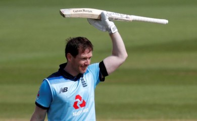 England's Eoin Morgan celebrates his century, as play resumes behind closed doors following the outbreak of the coronavirus disease (COVID-19) Adrian Dennis/Pool via REUTERS