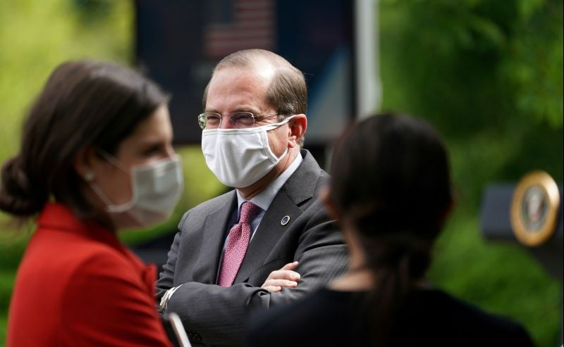 U.S. Health and Human Services Secretary Alex Azar wears a mask among other officials and media as U.S. President Donald Trump holds a coronavirus disease (COVID-19) outbreak response briefing in the Rose Garden at the White House in Washington, US on May 11, 2020. (REUTERS File Photo)