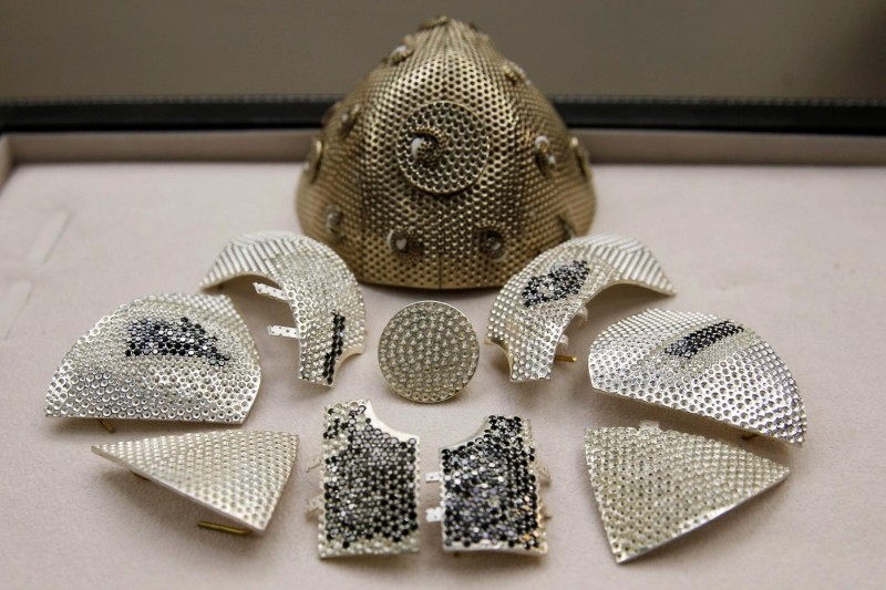 Parts of a diamond encrusted gold coronavirus disease (COVID-19) face mask, is seen in a fine jewelry factory in Motza, Israel August 11, 2020. Picture taken August 11, 2020. (Reuters Photo)