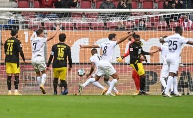 Augsburg's Felix Uduokhai (not pictured) celebrates scoring their first goal on September 26. Christof Stache/Pool via REUTERS