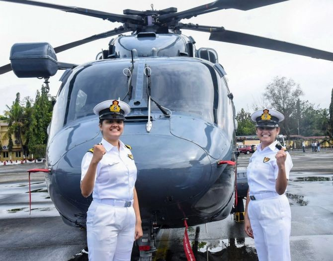 Sub Lt Riti Singh and Sub Lt Kumudini Tyagi, the first women airborne tacticians who will operate from deck of warships, pose for pictures after they passed out of Indian Navy's Observer Course, at Southern Naval Command, Kochi. Photograph: PTI Photo