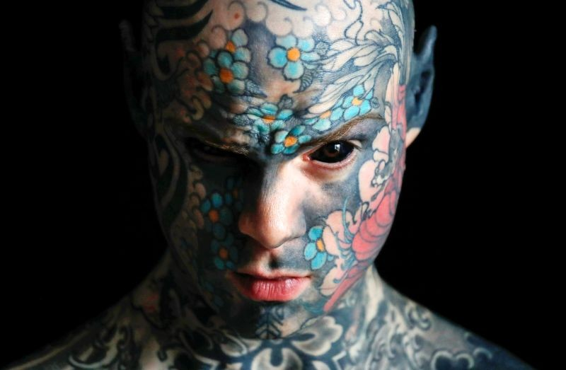 """Sylvain, alias Freaky Hoody, a primary school teacher and France's """"most tattooed man"""", poses with his eyes full of black ink at Palaiseau, southern Paris, France on September 25, 2020. (REUTERS Photo)"""