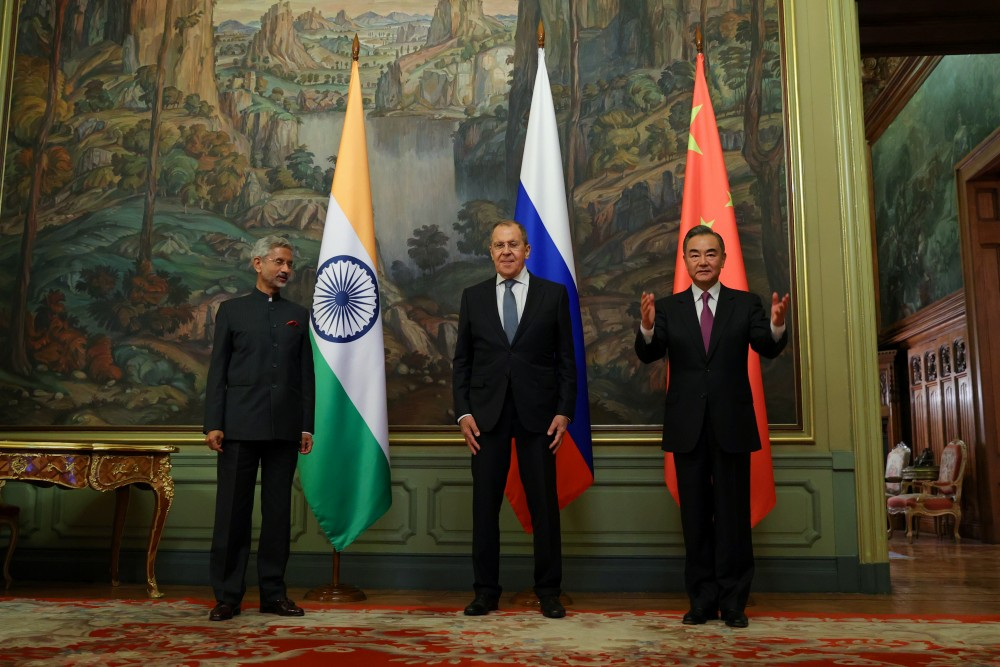 Russia's Foreign Minister Sergei Lavrov, India's Foreign Minister Subrahmanyam Jaishankar and China's State Councillor Wang Yi pose for a picture during a meeting in Moscow, Russia September 10, 2020. (Russian Foreign Ministry/Handout via REUTERS)