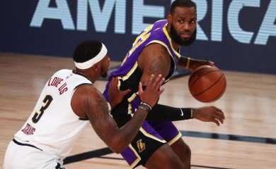 Los Angeles Lakers forward LeBron James (23) is defended by Denver Nuggets forward Torrey Craig (3) during the first half in game five of the Western Conference Finals of the 2020 NBA Playoffs at AdventHealth Arena. (USA TODAY Sports Photo via Reuters)
