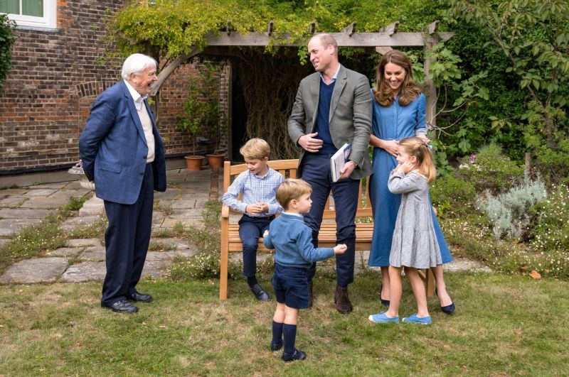 A handout photo released by Britain's Prince William and Cathrine, Duchess of Cambridge, Prince George (seated), Princess Charlotte and Prince Louis with David Attenborough after Prince William and David Attenborough attended an outdoor screening of the upcoming Attenborough's feature film, in the gardens of Kensington Palace, in London, Britain, September 24, 2020. (Duke and Duchess of Cambridge/Kensington Palace/Handout via REUTERS)