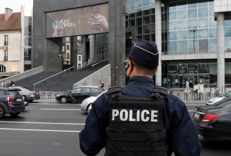A French police stands near the Opera Bastille where a suspect in a stabbing attack near the former offices of the magazine Charlie Hebdo has been arrested in Paris, France on September 25, 2020. (REUTERS Photo)