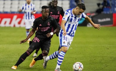 Real Madrid's Vinicius Junior in action with Real Sociedad's Andoni Gorosabel. REUTERS/Vincent West