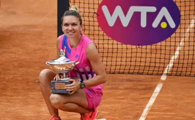 Romania's Simona Halep as she celebrates winning the final with the trophy after Czech Republic's Karolina Pliskova retired from the match after sustaining an injury Riccardo Antimiani/Pool via REUTERS